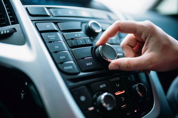 Closeup of young woman hand control radio volume