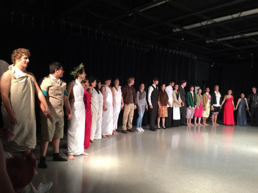 The actors taking a bow after their performance.
